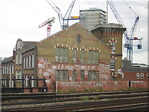 TQ3379 : Bermondsey: former factory, from the train by Christopher Hilton
