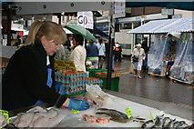 SP0198 : Fishmonger on Walsall Market by Derek Bennett