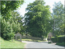SP7014 : Road passes the bus shelter at Ashendon church by Sarah Charlesworth
