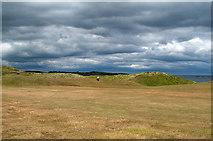 NU2422 : Golf course and sand dunes at Embleton by Trevor Littlewood