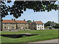 SE7485 : The old post office and old packhorse bridge, Sinnington by Pauline E