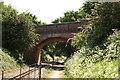 TG2820 : Tunstead Road bridge by Glen Denny