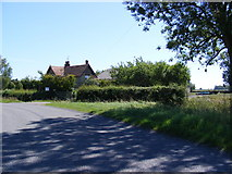 TL2966 : Hilton Road & Hilton End Farm by Adrian Cable