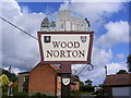 TG0127 : Wood Norton Village sign by Adrian Cable