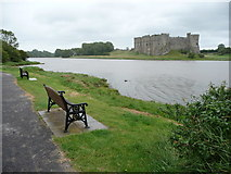 SN0403 : Benches looking towards Carew Castle by Jeremy Bolwell
