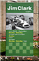 NT7853 : A signboard at the Jim Clark Room, Duns by Walter Baxter