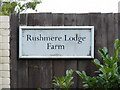 TM4259 : Rushmere Lodge Farm sign by Adrian Cable