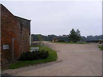 TG0723 : Footpath to Kerdiston Road & entrance to Brick Kiln Farm by Adrian Cable