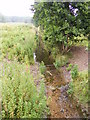 TG0324 : Stream before it passes under Reepham Road by Adrian Cable