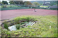 NR8668 : Crater in Tarbert tennis courts by Jonathan Long