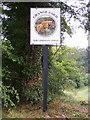 TM3677 : Grange Farm sign by Geographer