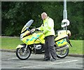 NX4165 : Police Motorcycle in Attendance by Andy Farrington