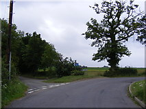 TM2557 : Sandy Lane & Entrance to Seven Stars Farm by Adrian Cable