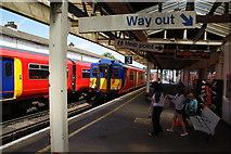 TQ2673 : Trains passing at Earlsfield Station by Bill Boaden