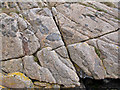 NM3019 : Detail of granite at Knockvologan by William Starkey