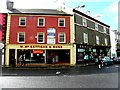 G9278 : McGettigan & Sons, Donegal Town by Kenneth  Allen