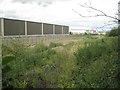 SP2599 : South boundary of Birch Coppice Business Park  by Robin Stott