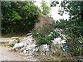 SE5115 : Fly tipping by the former railway bridge, Long Lane by Christine Johnstone