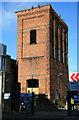 TQ3380 : Hydraulic accumulator tower, Mansell Street by Chris Allen