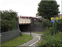 TQ1882 : Central Line train over cycle track by Hanger Lane Gyratory by David Hawgood