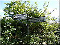 TM2057 : Roadsign at the Bastings Hall junction on Otley Road by Adrian Cable