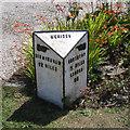 SP2481 : Milestone in a front garden, Main Road  by Robin Stott