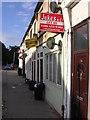 TQ3269 : Converted shops, Grange Road by Christopher Hilton