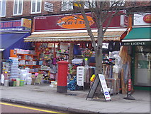 TQ3187 : Value 4 Money, Stroud Green Road by David Howard