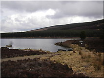 NN7754 : Fishing hut and boats, Loch Kinardochy by Peter Bond