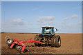 NU1336 : Tilling a field at Ross Farm by Walter Baxter