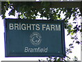 TM4072 : Brights Farm sign by Adrian Cable
