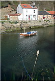 NZ7818 : Boat in Staithes Beck by Graham Horn