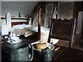 SH7877 : Bed and table, furnished attic room at Plas Mawr by Phil Champion