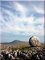 SD7075 : Perched limestone boulder and Ingleborough by Karl and Ali