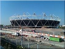 TQ3783 : Olympic Stadium under construction by David Martin