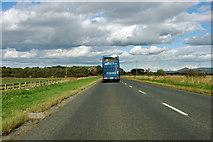 NZ5005 : Blue coach on A172 by Robin Webster