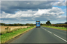 NZ5408 : Blue coach on A173 by Robin Webster