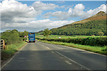 NZ5612 : A173 passes Roseberry Topping by Robin Webster
