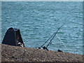 SZ2990 : Milford on Sea: angler on the beach by Chris Downer