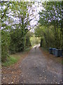 TM3072 : Footpath to the B1117 & Entrance to Grove Farm by Adrian Cable