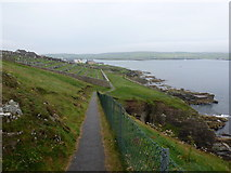 HU4840 : Lerwick: the coastal path passes the cemetery by Chris Downer