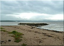 NX6548 : Sand and rocks at Nun Mill Bay by Ann Cook
