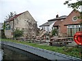 SK6580 : Beer garden and moorings at the Chequers Inn by Christine Johnstone