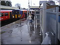 TQ1572 : Train arrival in storm at Strawberry Hill station by David Howard