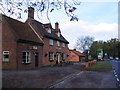 TM1376 : The Swan Public House and the A140 by Adrian Cable