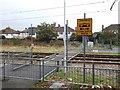 TQ3066 : Tram crossing near Ampere Way by David Anstiss