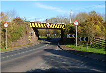 SO6913 : Railway bridge over a tight bend in the A48, Broadoak by Jaggery