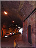 TQ3379 : Shand St, SE1, under the viaduct to London Bridge Station by Christopher Hilton