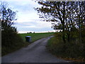 TM3585 : Footpath to High Street & Entrance to Highfield Farm by Adrian Cable