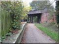SJ6168 : Whitegate former station plastform and road bridge by Dr Duncan Pepper